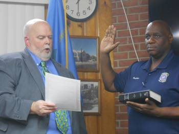Council Member Duane E. Bivans takes the oath of office, administered by City Solicitor William Pepper, to represent the 6th District.