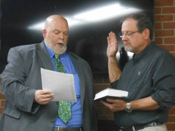 City Solicitor William Pepper administers the oath of office to Mayor Anthony R. Moyer.